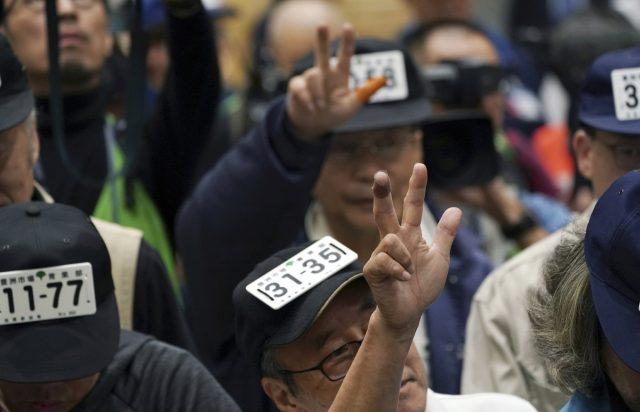 AP Photo by Eugene Hoshiko